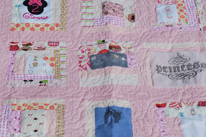 Turning baby clothes into a quilt. Or better, having someone talented do it for you.