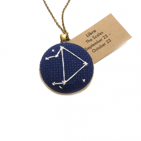 We're star-struck over these hand-stitched zodiac necklaces.