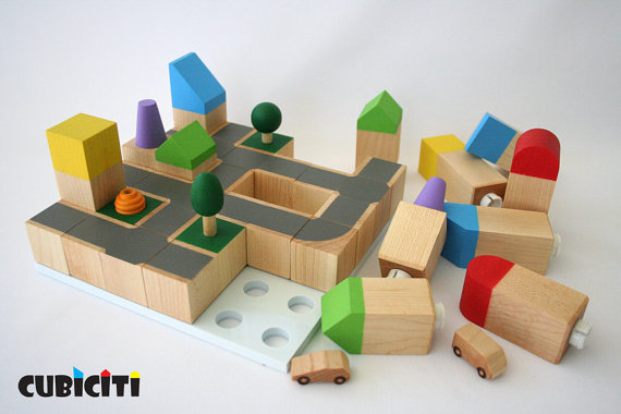 Natural handmade wooden block sets for kids, ready to become the city of their dreams