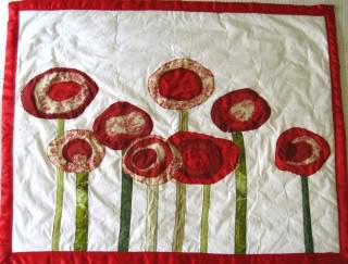 A poppy quilt that makes my uterus jump