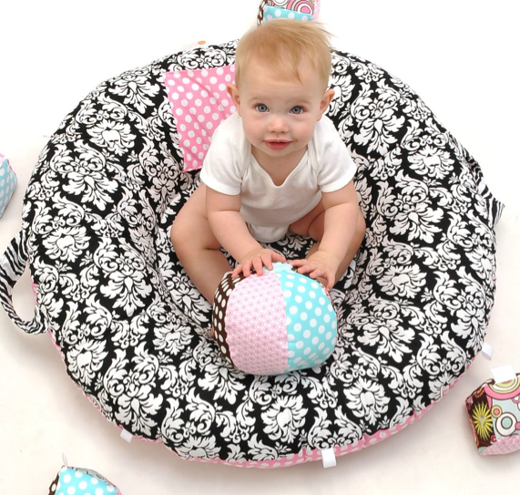 Meet the newest tummy-time floor pillow for babies (then wonder whether they make them for adults.)