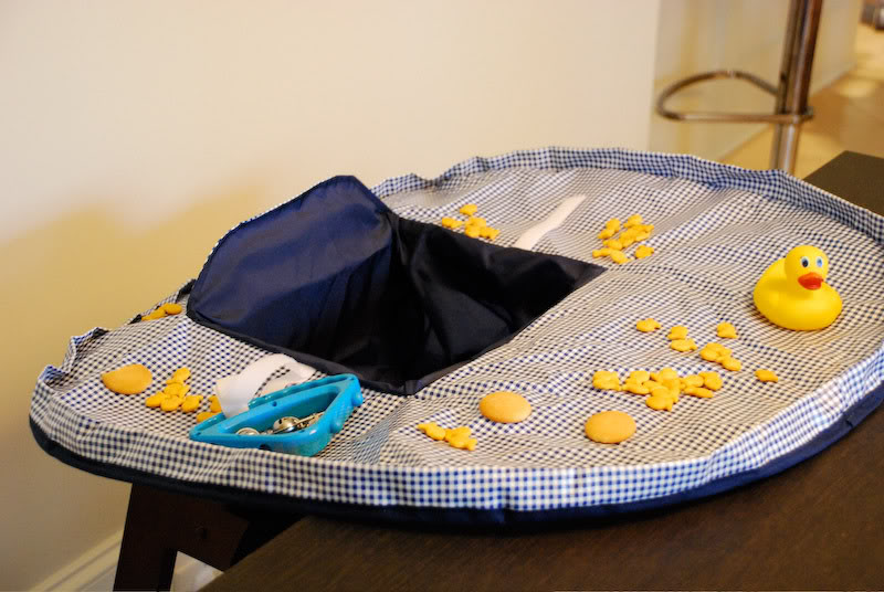 The Neatnik Saucer – A better option than high chair covers the size of a schoolbus