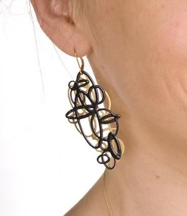 gold_and_black_circle_earrings_on_m