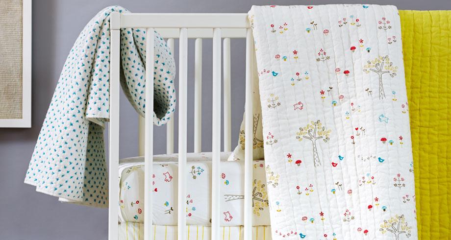 Little Auggie gender neutral crib bedding | Cool Mom Picks