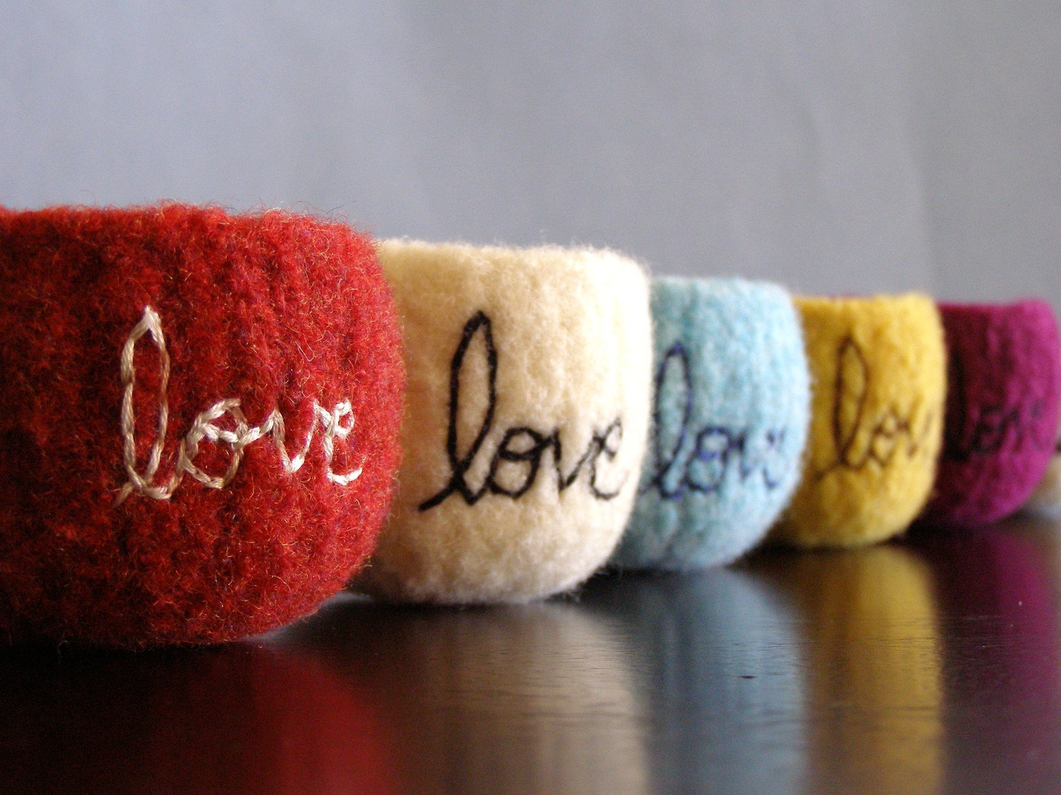 Felted wool bowls full of love. Or better, jewelry for Mother's Day.