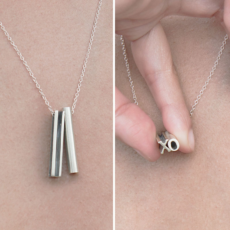 This custom hidden message necklace has two letters and a lot of love