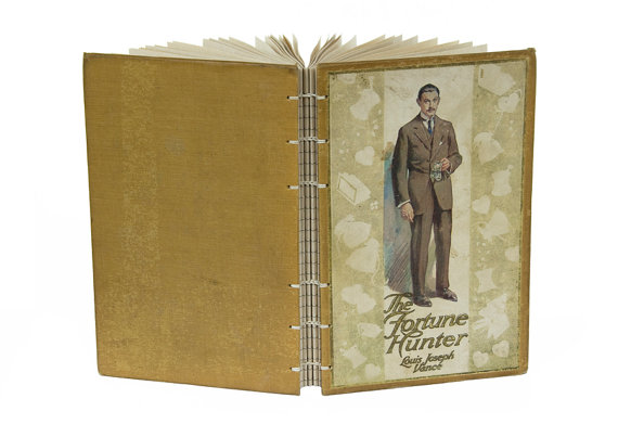 The Fortune Hunter recycled book journal on Etsy