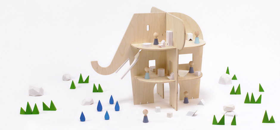A natural wooden dollhouse so adorable, an elephant couldn't forget it. Especially in this case.