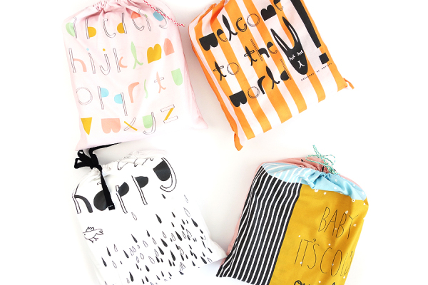 Handmade baby blankets in matching pouches | Designed By Artists