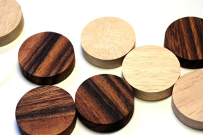 A four in a row wood game too beautiful to be stashed in your toy closet