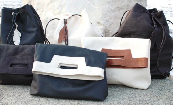 SheNatie handmade envelope clutches and bucket bags, providing opportunities to Native North American women