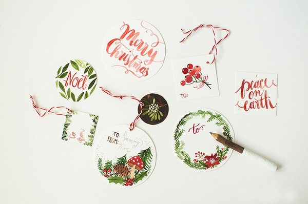 We love these watercolor Christmas printable gift tags from artist Oana Befort at HelloBee.