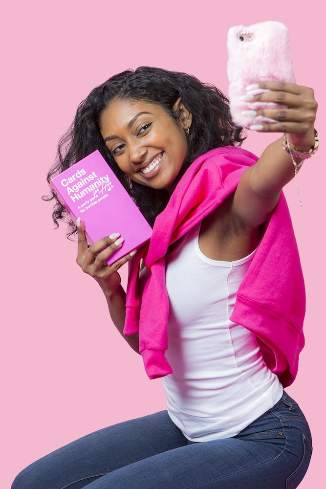 Cards Against Humanity for Her. The pink deck raises money for an amazing case + the website is a hilarious must-read | coolmompicks.com