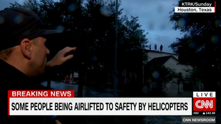 The journalists who are saving lives in and around Houston: A rooftop rescue by Foti Kallergis