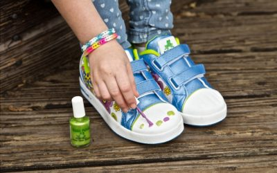 Giving kids a pedicure on the outside of their shoes.