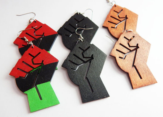 Cool feminist gifts supporting women-owned shops: Power fist earrings by The Blacker The Berry