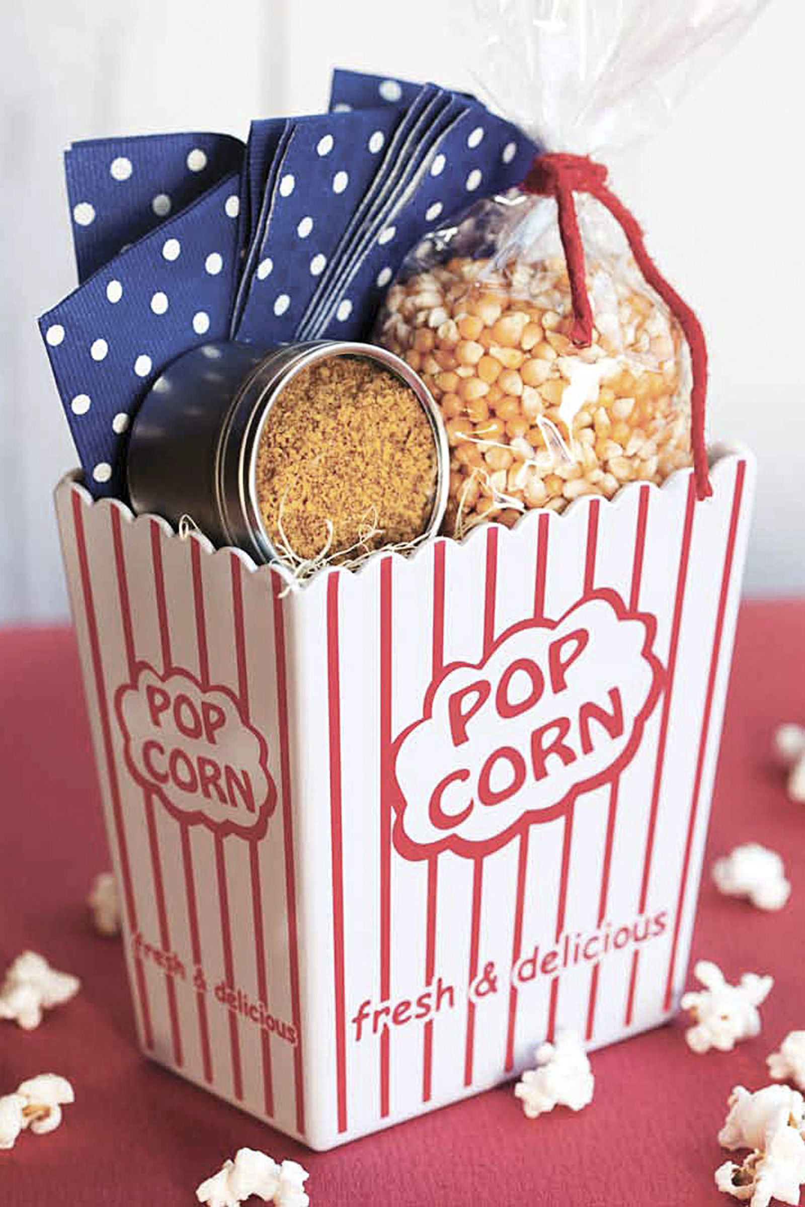 How to make gift cards more special: Drop your gift card into a DIY bucket of popcorn like this by Country Living.