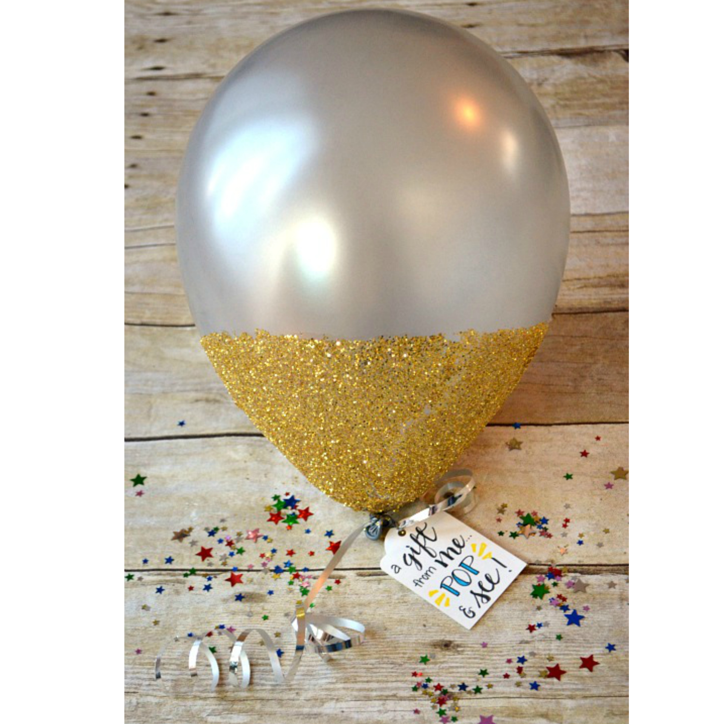 How to make gift cards more special: A great way to give a cash gift card is in a glitter dipped balloon like this one by dancers4life on One Artsy Mama.