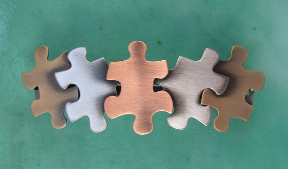 A puzzle piece barrette that just fits for World Autism Awareness Day