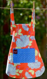 Children's aprons as pretty as the clothes underneath
