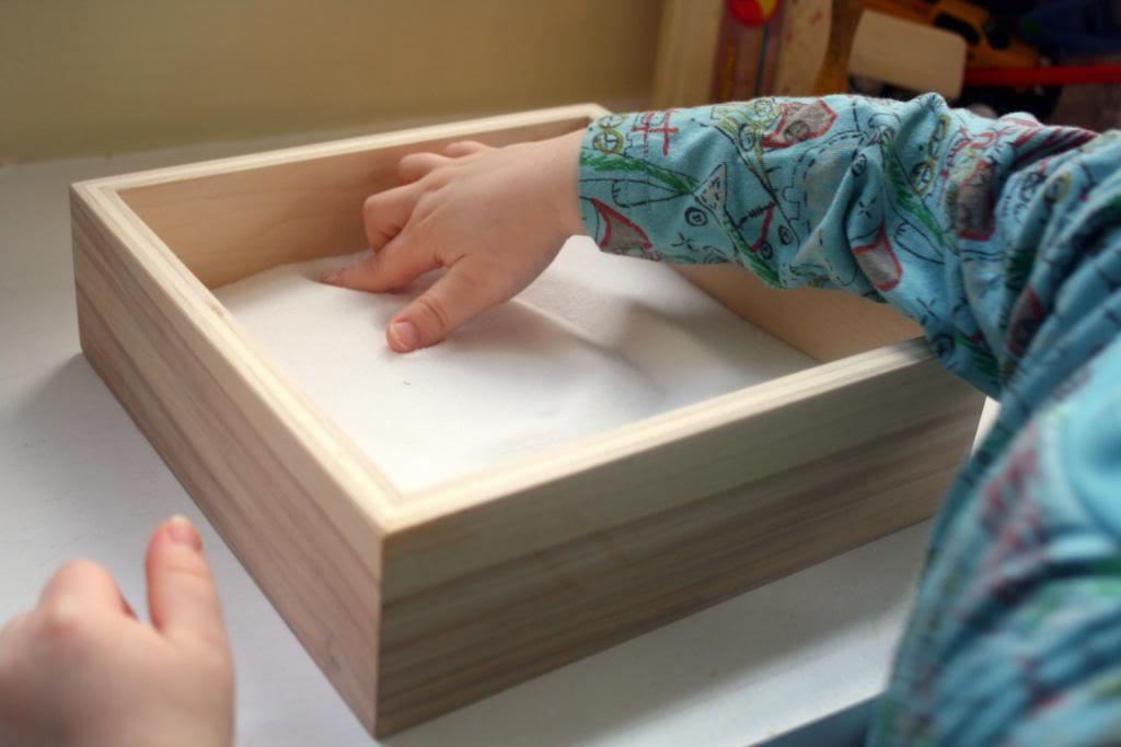 Montessori style fun in a box. Actually, it is a box.