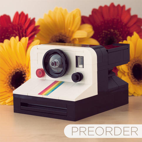 "Say cheese. This fun LEGO Polaroid ""camera"" has us grinning."