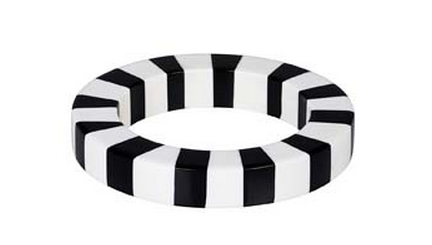 A black and white striped bracelet that means the '80s are back, and coming to a wrist near you