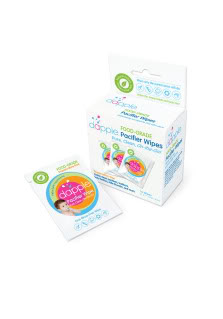 Cleaning dirty pacifiers on the go with Dapple SurfaceWipes