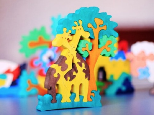 Wooden giraffe puzzle   Cool Mom Picks