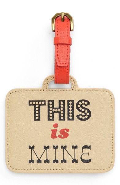 The luggage tag that says hands off. Pretty clearly.
