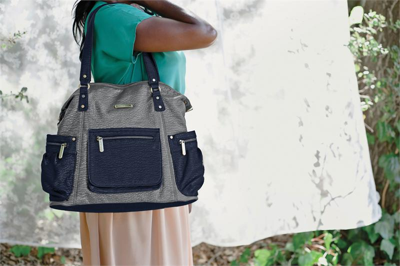 The new designer diaper bags from Timi & Leslie hold a lot. Because heaven knows moms carry more than diapers with them.