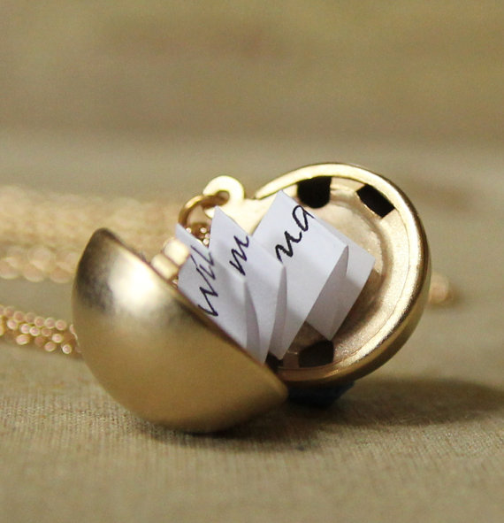 Vintage lockets on Etsy that hold more than secret photos, they hold a secret message.