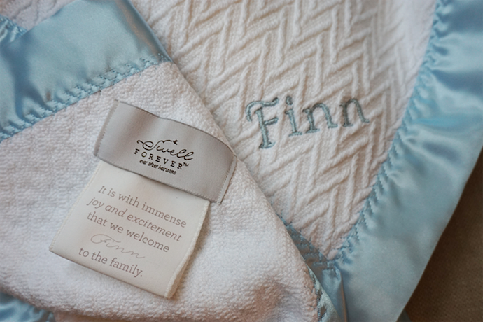 Best adoption gifts: A Swell Forever baby blanket with a custom message