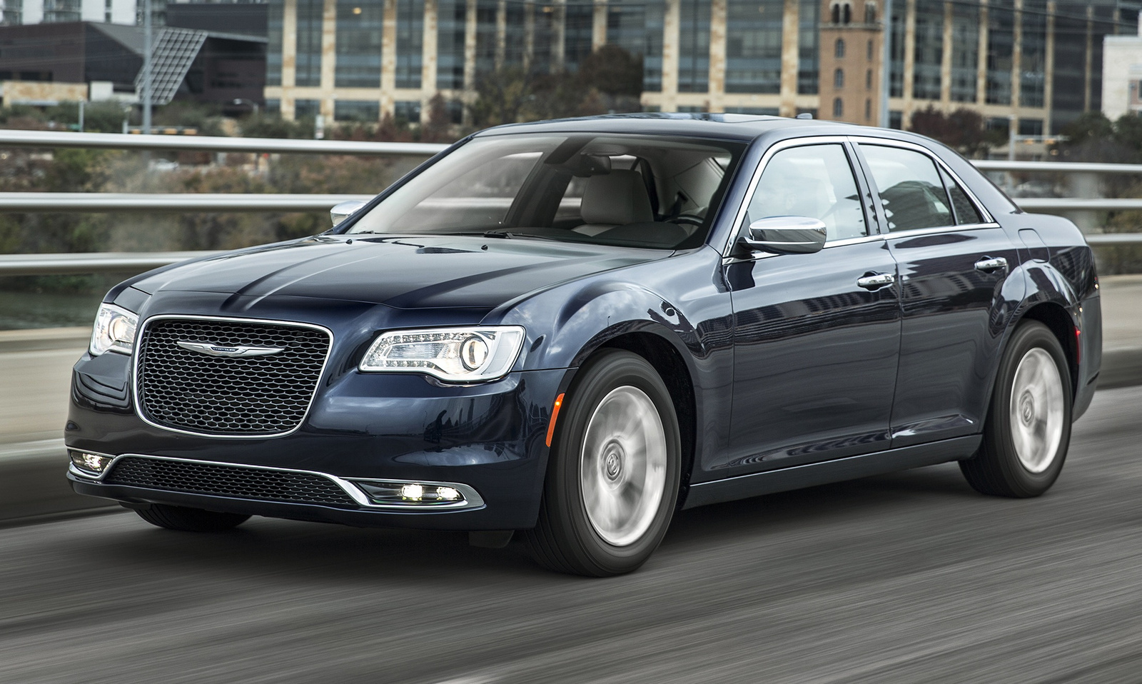 Cars for big families: The Chrysler 300 safely accommodates 3 child seats together in the second row