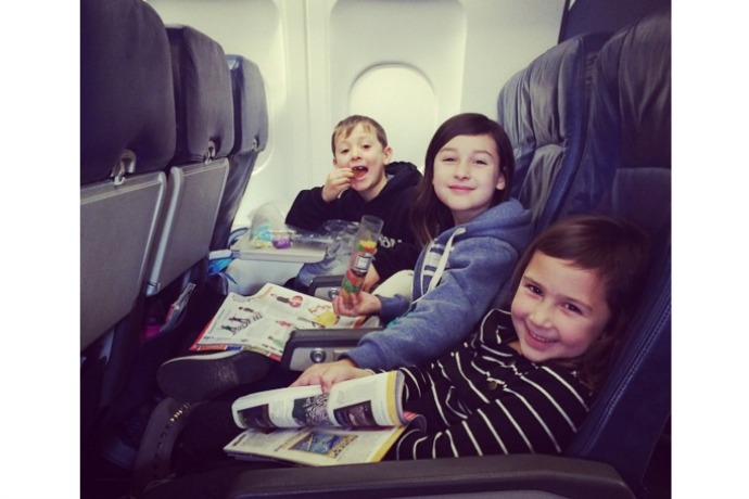 Helpful tips for flying with kids from been-there-done-that moms who survived. Mostly.