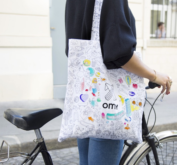Color-your-own bags and accessories for kids from OMY include a backpack and this tote. Fun!