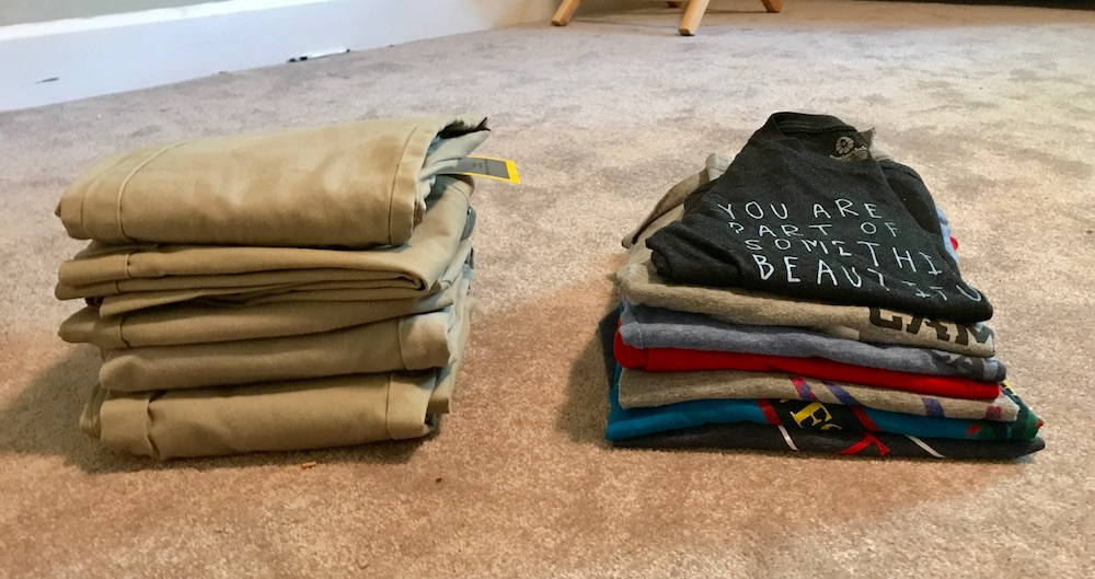 How to make a capsule wardrobe for kids: Piles of clothes, after paring down.