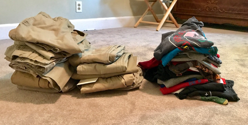 How to make a capsule wardrobe for kids: Piles of clothes, before.