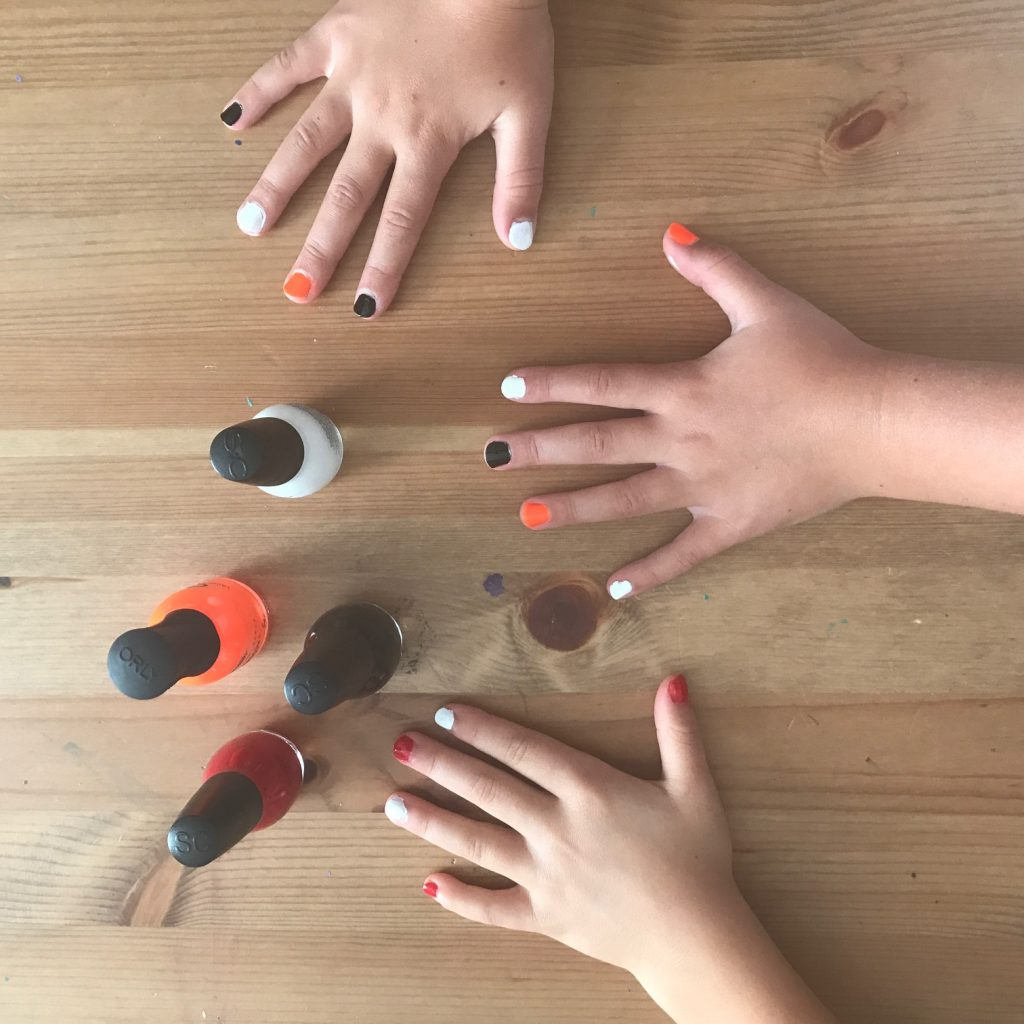 8 subtle ways your kids can show their team spirit: Color coordinated nail polish