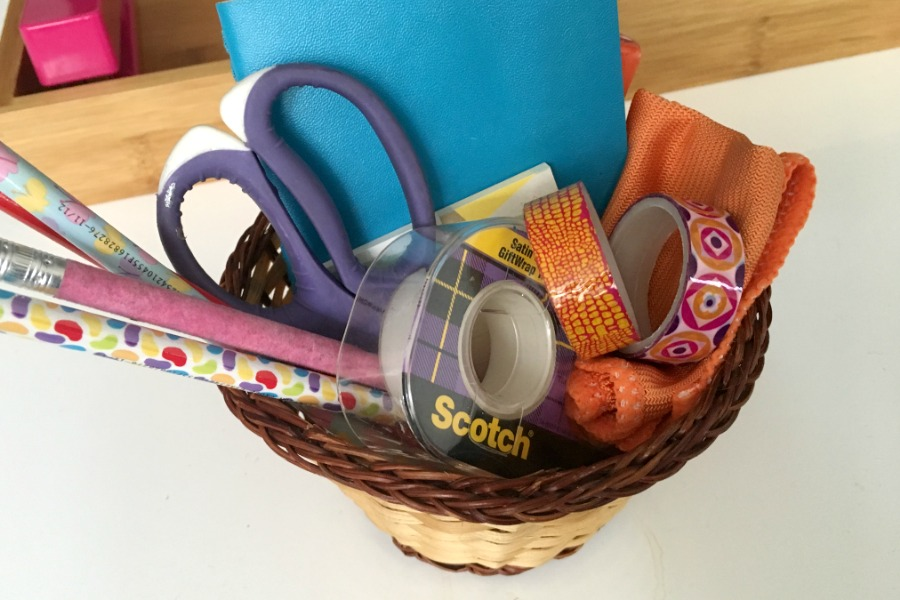 Basket of school supplies for creating a portable homework hub for kids