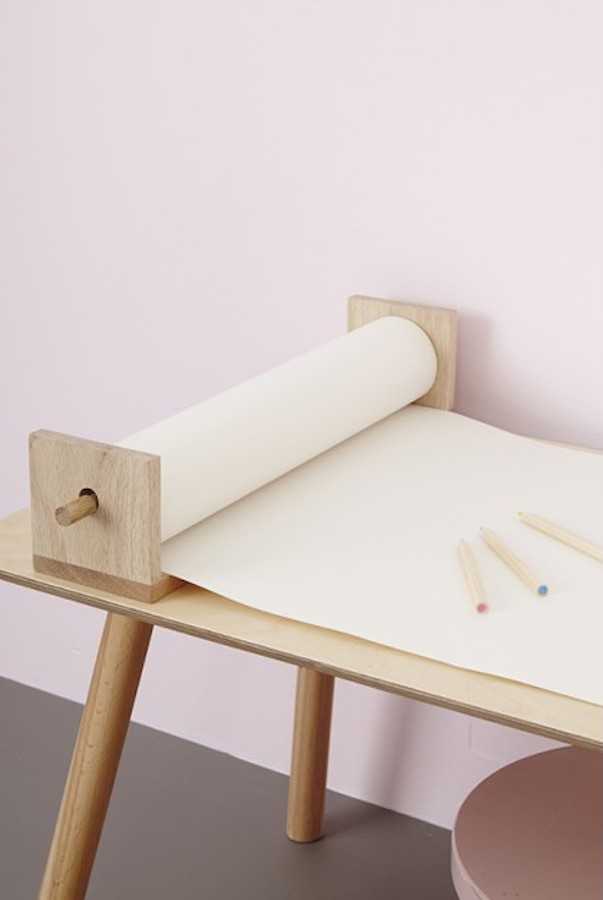 The Pollie shelf holds blank rolls of paper or Playpa preprinted coloring rolls on the wall, or use right on a crafting table