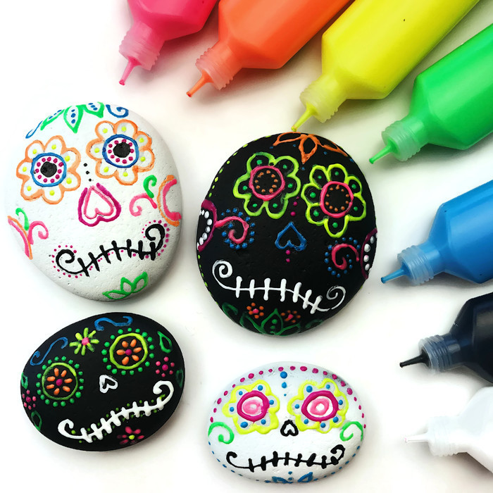 Sugar skull crafts | sugar skull painted rocks from Color Made Happy