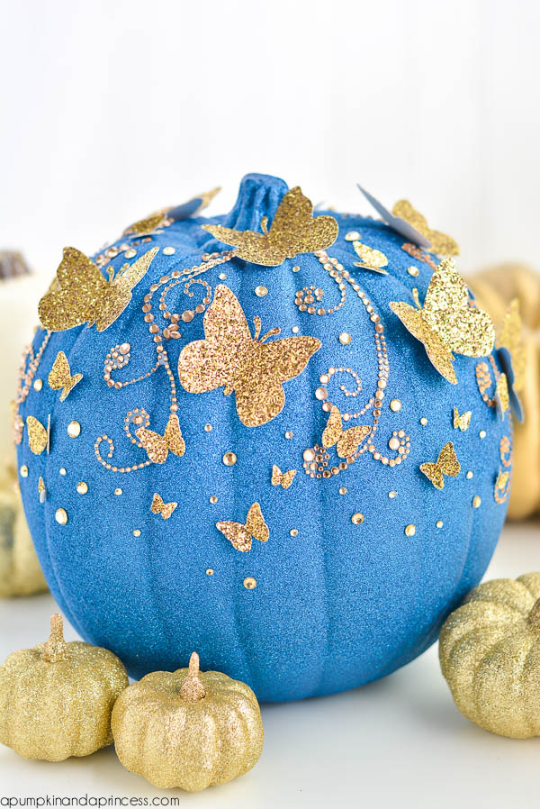 Teal pumpkin decorating ideas: Adapt this DIY for a Cinderella Butterfly Pumpkin from A Pumpkin and A Princess using teal instead of royal blue