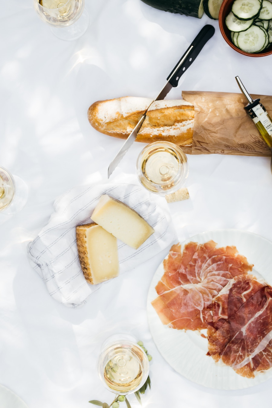 At home date-night ideas: Wine and cheese tasting | Photo by Ingrid Hofstra via Unsplash
