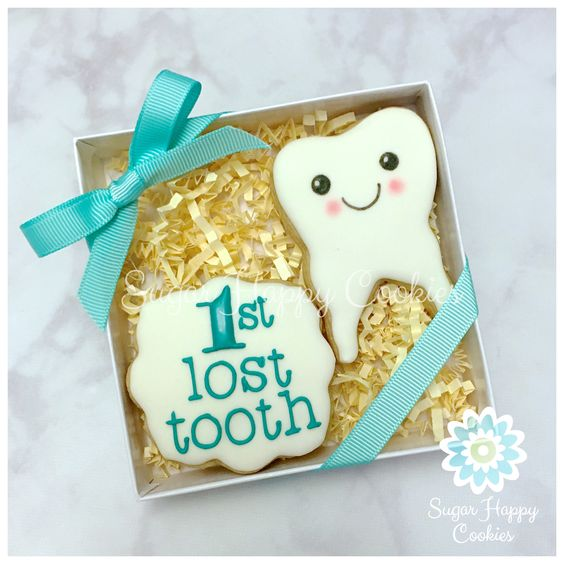 Adorable Tooth Fairy Traditions | Tooth Cookie Gift by Sugar Happy Cookies | Cool Mom Picks
