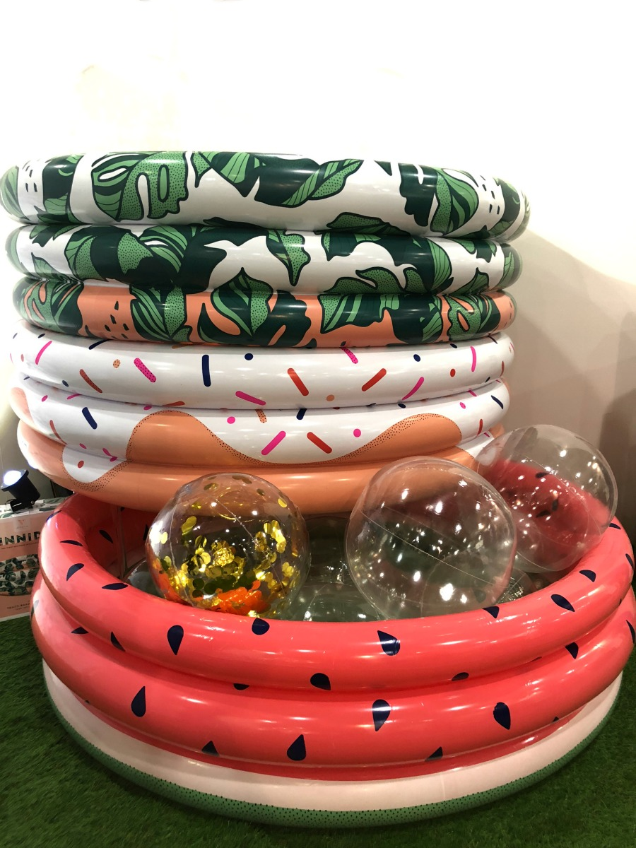 Minnidip modern inflatable pools in modern patterns like watermelons, donuts and tropical banana leaves
