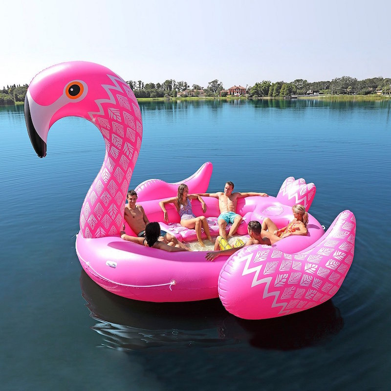 The giant flamingo pool float is more like a boat, holding 6 people