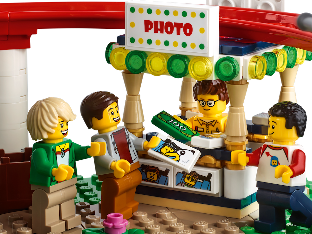 The new LEGO Creator Roller Coaster set has details like a photo booth, cotton candy stand, and height marker