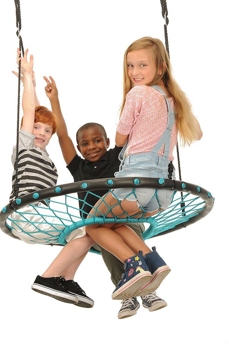 Cool backyard swings for kids: Tarzan Tire Spider Web