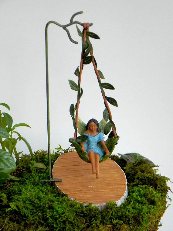 Fairy garden ideas: Mini fairy garden figurine swinging from a leaf